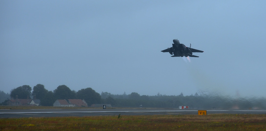 An F-15E Strike Eagle assigned to the 494th Fighter Squadron departs Royal Air Force Lakenheath, England, July 10, 2014, to participate in a series of training exercises in the U.S. The 48th Fighter Wing aircraft will contribute to Red Flag exercise 14N-3 at Nellis Air Force Base, Nev., and the Combat Hammer and Combat Archer exercises at Hill Air Force Base, Utah. (U.S. Air Force photo by Staff Sgt. Thomas Trower/Released)