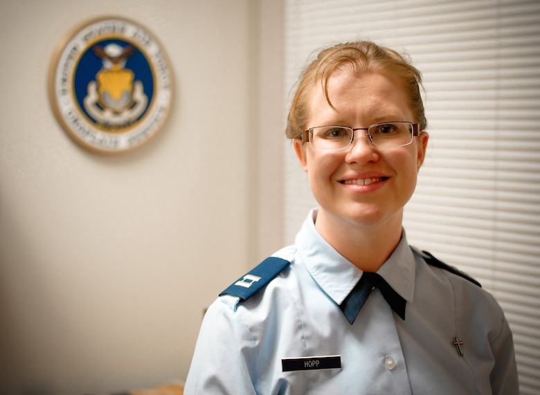 "U.S. Air Force Chaplain (Capt.) Kristi L. Hopp serves as a chaplain at the 182nd Airlift Wing in Peoria, Ill., pictured May 5, 2014. Hopp received ordination as a United Methodist Church minister June 6, 2014, after completing an 8-year process of education and evaluation. She first became interested in the military during a Veterans Affairs hospital internship. ""The stressors that we all are under in the Guard and being deployed are different. And yeah, sometimes we come back wounded, but then that's kind of what war does,"" she said. ""It might not always wound us on the outside, but it can wound us on the inside. And so, it's a very rewarding ministry to be able to serve here."" (U.S. Air National Guard photo illustration by Staff Sgt. Lealan Buehrer/Released)"