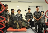 Students from the Republic of Korea Aeromedical Center Primary Flight Nurse Course listen to a briefing about the 51st Medical Group's decontamination procedures during a tour of the facility at Osan Air Base, ROK, July 11, 2014. Nine flight nurses from different branches of the ROK military participated in the tour, along with the center's chief nurse, ROK air force Lt. Col. Ji Ah Jeong. (U.S. Air Force photo/Airman 1st Class Ashley J. Thum)