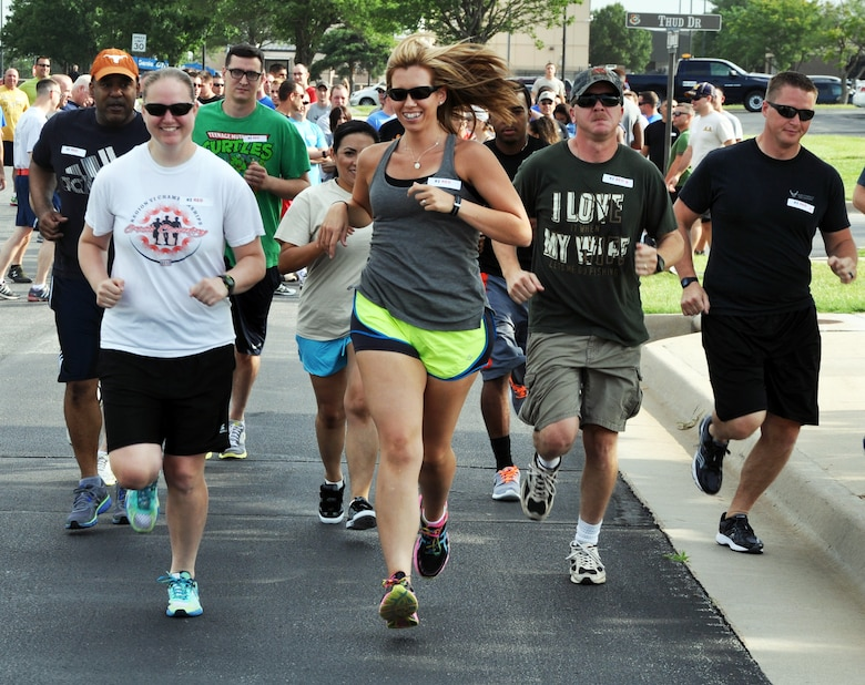 "Members of the 931st Air Refueling Group start the ""Amazing Race"" as part of the unit's 2014 ""Wingman Day"" event, July 13, 2014.  Wingman Day is a day designated to promote resiliency, teamwork and trust among Air Force members. The 931 ARG Wingman Day incorporated several activities that required interaction, teamwork and trust to accomplish, as well as briefings on taking care of and supporting fellow Airmen. (U.S. Air Force photo by Capt. Zach Anderson)"