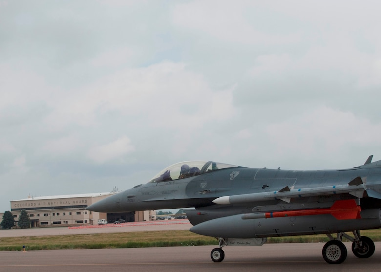 Colorado Air National Guard F-16s return home to Buckley Air Force Base after being housed temporarily at Denver International Airport for the last three months, Buckley AFB, Aurora Colo., July 12, 2014. The partnership between DIA and the COANG  allowed necessary runway reconstruction at Buckley AFB to take place while also providing F-16 pilots the opportunity to continue their 24/7 alert mission and vital training flights twice a day at DIA. Construction on the runway will continue through September, however the airfield is back to operational status. (U.S. Air National Guard photo by Senior Airman Michelle Y. Alvarez-Rea)