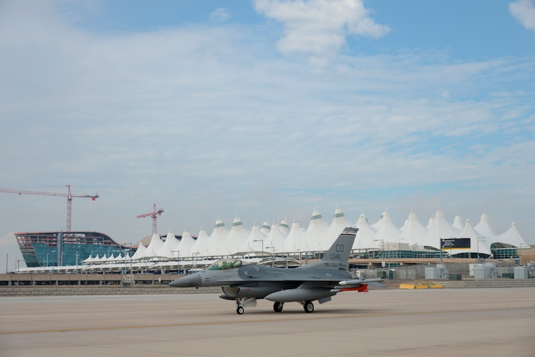F-16s from the 140th Wing, Colorado Air National Guard begin to return to Buckley Air Force Base July 12, 2014, slightly ahead of schedule, after spending approximately three months at Denver International Airport while the base runway was being reconstructed. Despite relocating their entire flying operations, the wing managed to provide uninterrupted support to their Aerospace Control Alert mission 24/7 throughout the transition to DIA and back to Buckley AFB. (Air National Guard Photo by Tech. Sgt. Wolfram Stumpf)