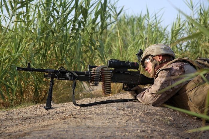 Lance Cpl. Michael Manues, machine gunner, Bravo Company, 1st Battalion, 7th Marine Regiment, provides security with an M240B medium machine gun during a mission in Helmand province, Afghanistan, July 6, 2014. Manues, a native of Pelion, S.C., and the company operated in Gereshk for three days and were involved in numerous kinetic engagements with Taliban insurgents.