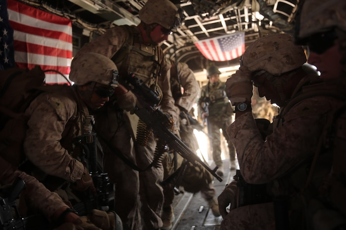 Marines with Bravo Company, 1st Battalion, 7th Marine Regiment, load onto a CH-53E Super Stallion helicopter during a mission in Helmand province, Afghanistan, July 4, 2014. The company operated in Gereshk for three days and was involved in numerous kinetic engagements with Taliban insurgents.