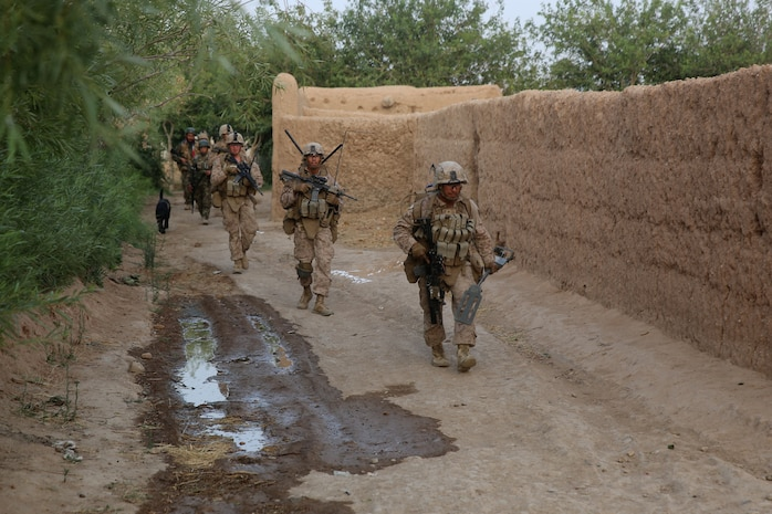 Marines with Bravo Company, 1st Battalion, 7th Marine Regiment, patrol to their next objective during a mission in Helmand province, Afghanistan, July 4, 2014. The company operated in Gereshk for three days and was involved in numerous kinetic engagements with Taliban insurgents. (U.S. Marine Corps photo by Cpl. Joseph Scanlan / released)