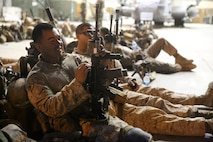 Petty Officer 3rd Class Christian Melendez, corpsman, Bravo Company, 1st Battalion, 7th Marine Regiment, rests next to his gear before a mission in Helmand province, Afghanistan, July 4, 2014. Melendez, a native of El Paso, Texas, and the company operated in Gereshk for three days and were involved in numerous kinetic engagements with Taliban insurgents.