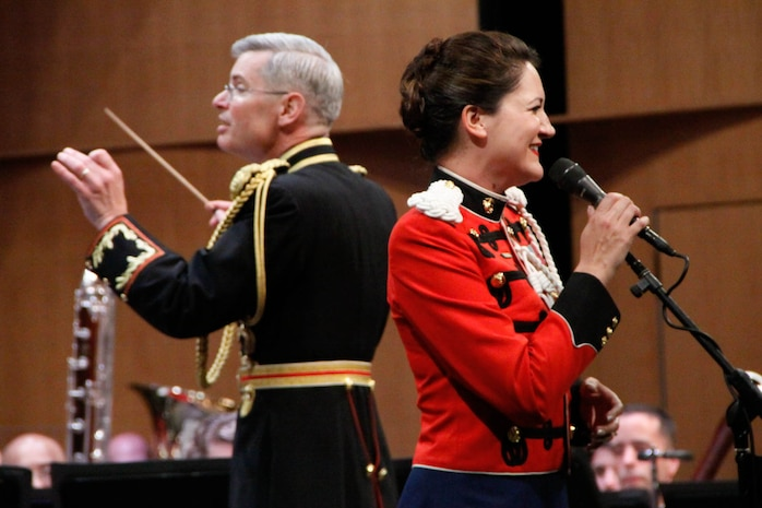 """On July 12, 2014, Colonel Michael J. Colburn passed the John Philip Sousa Baton and command of """"The President's Own"""" United States Marine Band to Assistant Director Lt. Col. Jason K. Fettig. Following the ceremony Col. Colburn retired after serving 27 years in the Marine Corps. Pictured, Col. Colburn conducting Memories, Very Pleasant and Rather Sad: A Charles Ives Song Set featuring Gunnery Sgt. Sara Dell'Omo. (U.S. Marine Corps photo by Staff Sgt. Rachel Ghadiali/released)"""