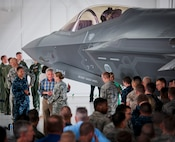 Defense Secretary Chuck Hagel meets a 33rd Fighter Wing Airman July 10, 2014, at Eglin Air Force Base, Fla. Hagel visited the base to tour the wing and the F-35 Lightning II integrated training center.  (U.S. Air Force photo/Samuel King Jr.)
