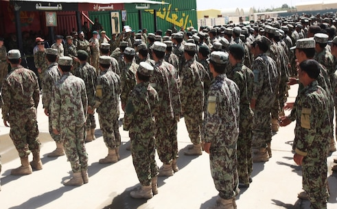Afghan National Army soldiers with the 215th Corps stand in formation during their graduation ceremony aboard Camp Shorabak, Afghanistan, July 10, 2014. More than 650 soldiers graduated a completely Afghan-led, six-week combat training course, which consisted of 29 courses varying from hands-on weapons training to rifleman tactics. (U.S. Marine Corps photo by Cpl. Cody Haas/ Released)