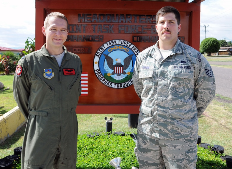 U.S. Air Force Capt. Daniel Gruben (left) and U.S. Air Force Staff Sgt. Zachary Yoakam provided life-saving first aid to a Honduran boy injured when a vehicle struck him in the Arturo Quezada residential area of Tegucigalpa, Honduras, July 9, 2014.  Gruben and Yoakam were returning to Soto Cano Air Base after a day of meetings in Tegucigalpa when they witnessed a truck striking the boy, Jose, at highway speed.  (Photo by U. S. Air National Guard Capt. Steven Stubbs)