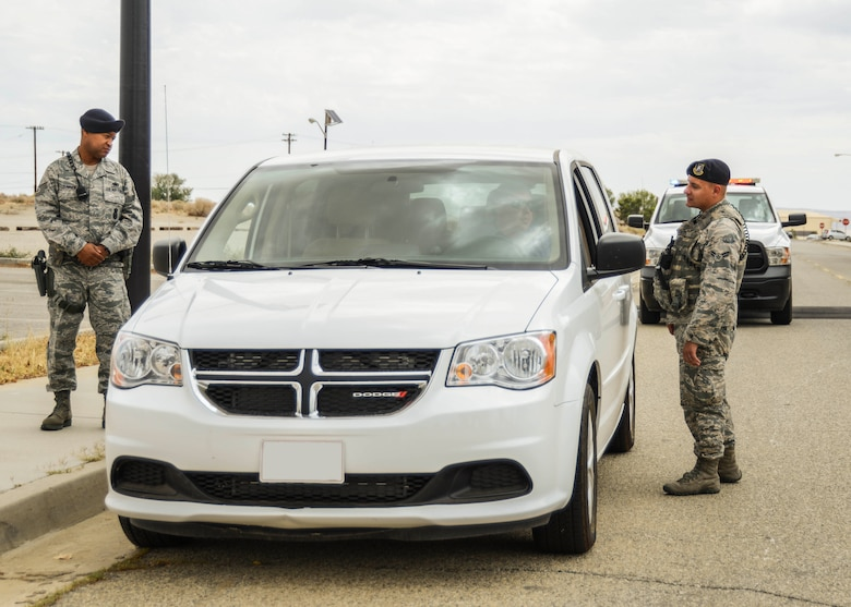 412th Security Forces Squadron defenders pull over a vehicle for speeding. (U.S. Air Force photo by Rebecca Amber)