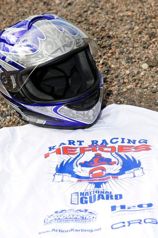 Team Buckley and local community members raced in the Kart Racing for Heroes event July 12, 2014, at Bandimere Speedway in Morrison, Colo. The event honored Senior Airman Michael Snyder and Senior Airman Kristopher Mansfield, both members of the 460th Space Communications Squadron who were killed by drunk drivers. (U.S. Air Force photo by Airman 1st Class Samantha Saulsbury/Released)