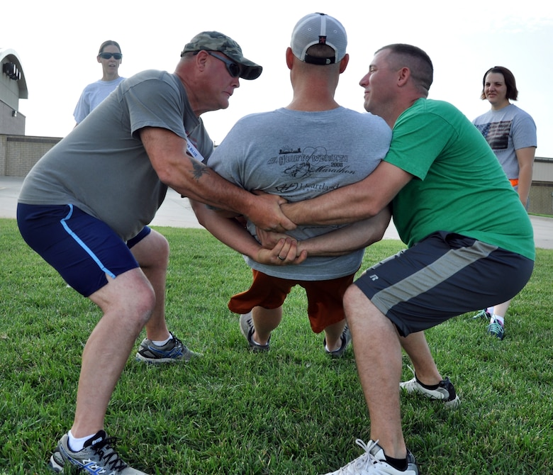 Members of the 931st Air Refueling Group perform a trust fall during the Group's annual Wingman Day at McConnell Air Force Base, Kan., July 13, 2014.  Wingman Day is a day designated to promote resiliency, teamwork and trust among Air Force members. The 931 ARG Wingman Day incorporated several activities that required interaction, teamwork and trust to accomplish, as well as briefings on taking care of and supporting fellow Airmen. (U.S. Air Force photo by Capt. Zach Anderson)