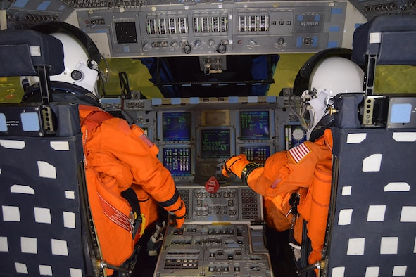 DAYTON, Ohio, --  Mannequins sit in the commander and pilot seats of the NASA Crew Compartment Trainer. . These replica pressure suits represent what astronauts wore during launch & entry. (U.S. Air Force photo)