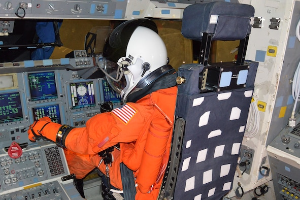 DAYTON, Ohio, --  A mannequin sits in the pilot's seat of the NASA Crew Compartment Trainer. . These replica pressure suits represent what astronauts wore during launch & entry. (U.S. Air Force photo)