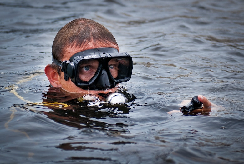 A Navy explosive ordnance disposal student surfaces from Weekly Bayou after a diving exercise at Eglin Air Force Base, Fla.  After completing the standard training course at Navy EOD school, Sailors attend the 55-day dive training on Eglin.  The Naval School EOD staff trains approximately 1,800 DOD military, civilian and international students annually.  (U.S. Air Force photo/Tech. Sgt. Samuel King Jr.)
