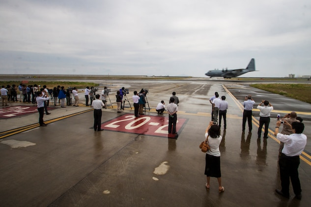 Japanese media takes photographs and video of a KC-130J Super Hercules during its arrival at Marine Corps Air Station Iwakuni, Japan, July 15, 2014. Upon the KC-130J Super Hercules' touchdown, administrative control of the squadron effectively changed from MCAS Futenma's, based out of Okinawa, Japan, Marine Aircraft Group-36 to MAG-12 on Iwakuni. VMGR-152 will remain under operational control of III Marine Expeditionary Force in Okinawa, but MAG-12 will be in charge of providing the squadron with all the gear and supplies necessary in carrying out their missions.