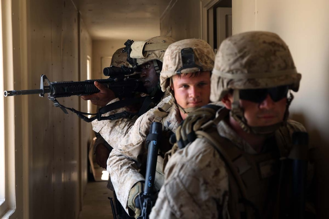 A team of Marines clear rooms in a mock hostile enemy compound during military operations on urban terrain training at Marine Corps Outlying Field Atlantic, N.C.,  July 7-11, 2014. The Marine focused on communication to ensure the training ran as smoothly as possible. The Marines are with 2nd Low Altitude Air Defense Battalion.