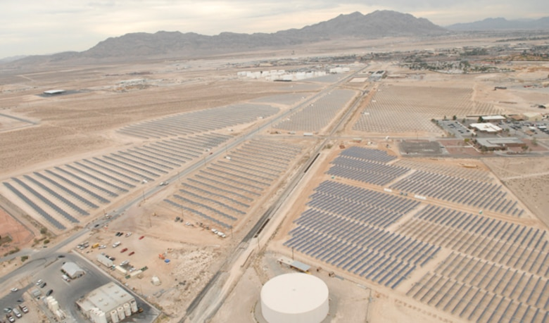 Nellis Air Force Base, Nev., plans to more than double its solar power production pictured here in 2007. Recently, Air Force officials signed a land lease with NV Energy, paving the way for construction of a 19-megawatt solar photovoltaic power system. NV Energy will provide a secondary substation and a transmission line as an in-kind consideration to the government for the lease. The substation will provide energy security and mission assurance by providing a redundant primary electric feed to the base. (U.S. Air Force photo)