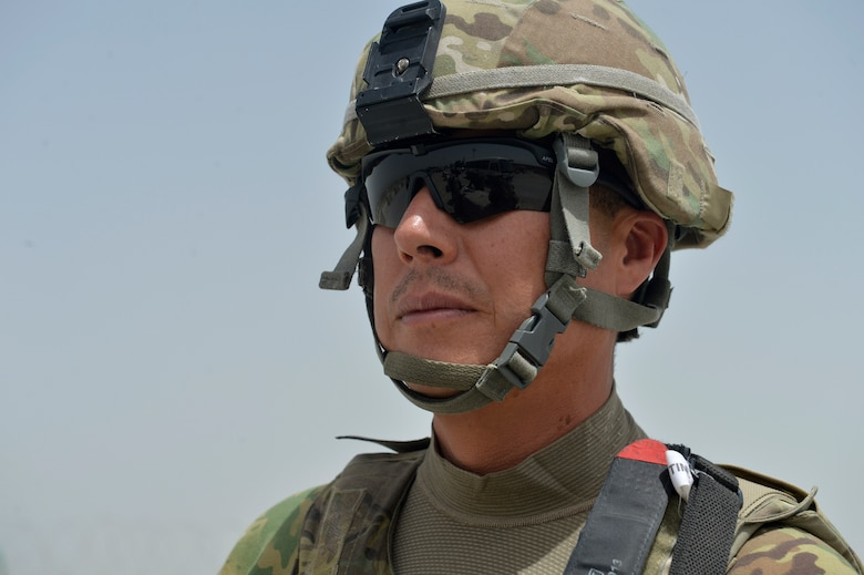 Staff Sgt. Jesus Yanez  stands at his post July 2, 2014, on Bagram Airfield, Afghanistan. Yanez has served in four military branches throughout his career. He is a 455th Expeditionary Base Defense Squadron defender. (U.S. Air Force photo/Staff Sgt. Evelyn Chavez)