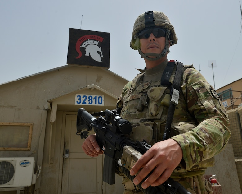 Staff Sgt. Jesus Yanez stands in front of his sector station July 2, 2014, on Bagram Airfield, Afghanistan. Yanez has served in four military branches throughout his career. He is a 455th Expeditionary Base Defense Squadron defender and a native of El Paso, Texas. (U.S. Air Force photo/Staff Sgt. Evelyn Chavez)