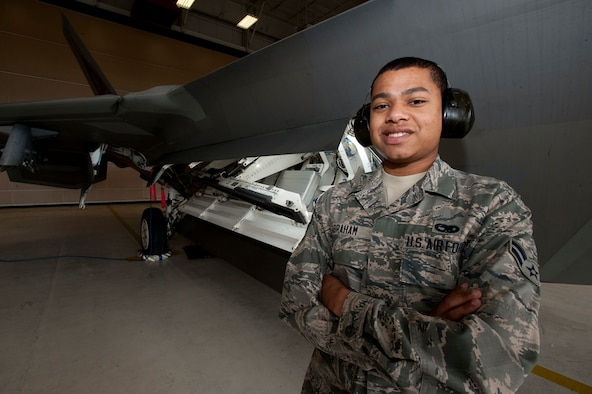 Airman 1st Class Kyron Abraham is an F-22 Raptor weapons specialist with the 3rd Aircraft Maintenance Squadron at Joint Base Elmendorf-Richardson, Alaska. Abraham is part of a three-man team that loads weapons onto the stealth fighters, and is a native of Reistertown, Md. (U.S. Air Force photo/Staff Sgt. Robert Barnett)