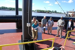 Thomas George's family christens the vessel bearing his name which will carry on the legacy of its namesake as it benefits the Mississippi River and those who depend on it.