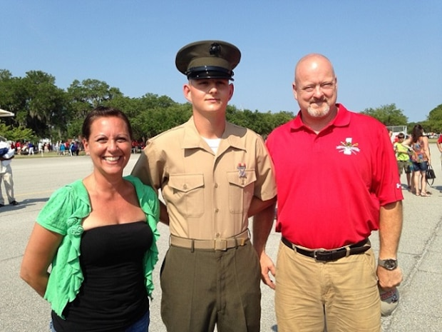 Doreen Kostiuk, mom, Private Daniel Pritchett, recent graduate of Bravo Company, 1st Battalion, and Kenneth Pritchett, dad, pose for a family photo after Basic Training Graduation on June 20, 2014 at Marine Corps Recruit Depot Parris Island. Kostiuk and K. Pritchett were support of their son joining.