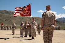 Col. John J. Carroll Jr., outgoing commanding officer, Marine Corps Mountain Warfare Training Center reports to MCAGCC, MAGTFTC Commanding General Maj. Gen. David H. Berger during a change of command ceremony hosted at Post 1, Marine Corps Mountain Warfare Training Center, June 27, 2014.