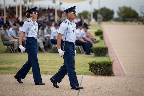 U.S. Air Force Academy Cadets 2nd Class Monica Kestermann (left) and Paul Yang get in position to lead the July 11 basic military training graduation parade at Joint Base San Antonio-Lackland. (U.S. Air Force photo/Joshua Rodriguez)