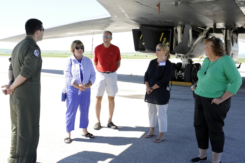 Members of the Military Impacted School Association listen as Capt. Austin Fouts, 23rd Bomb Squadron B-52 pilot from Minot Air Force Base, N.D., on temporary duty at Ellsworth Air Force Base, S.D., answers questions about being a B-52 aviator during a tour of Ellsworth June 24, 2014. Administrators and faculty from across the nation had the opportunity to see and learn about the B-1 bomber and B-52 during a base tour. (U.S. Air Force photo by 2nd Lt. Rachel Allison/Released)