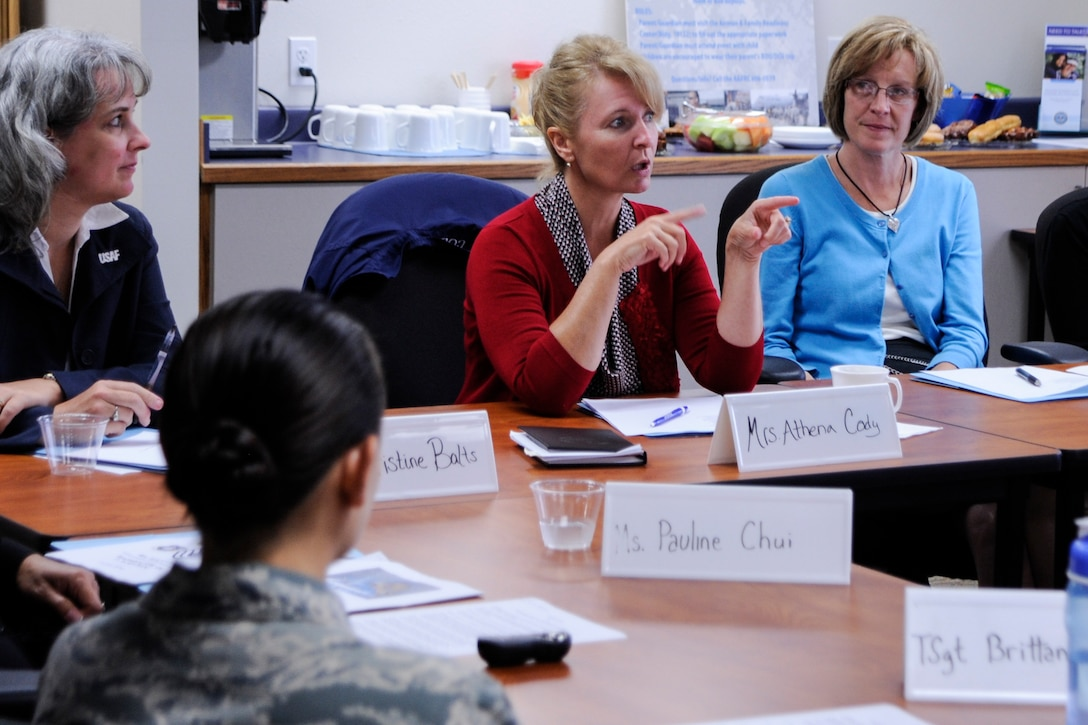 Mrs. Athena Cody, wife of Chief Master Sgt. of the Air Force, James A. Cody, visits with the Family Readiness Center staff July 8, 2014, Vandenberg Air Force Base, Calif. Mrs. Cody toured numerous that offer programs to improve quality of life for the enlisted force and their families. (U.S. Air Force photo by Airman 1st Class Yvonne Morales/Released)