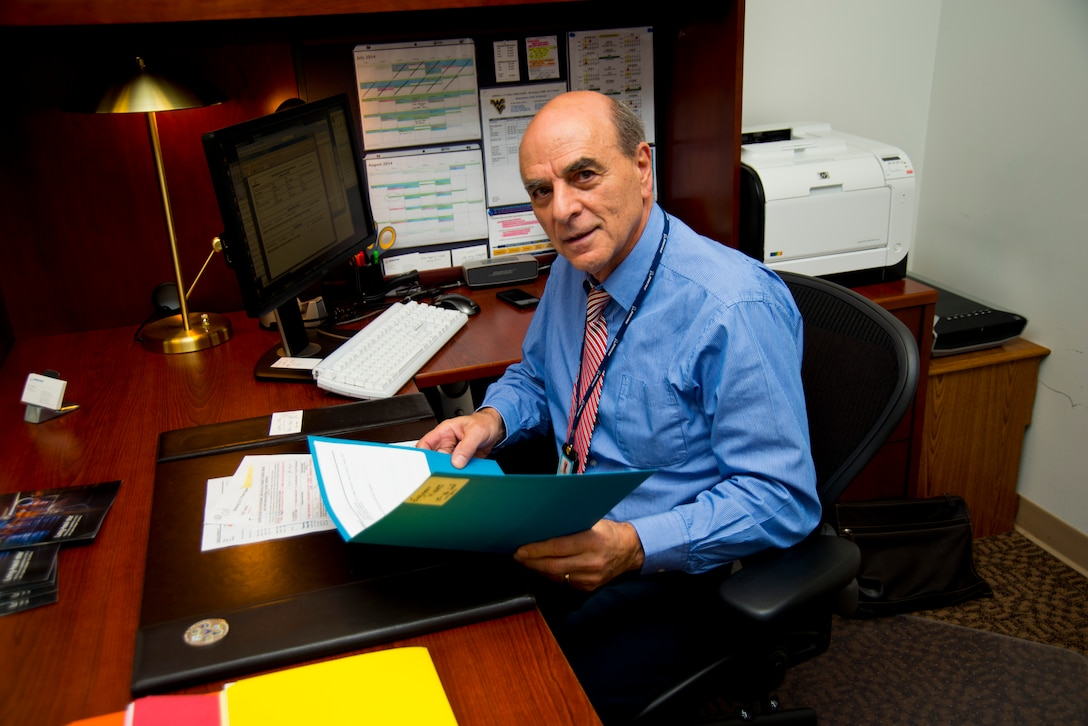 Tony Capoccia, the Boeing C-17 base manager assigned to the 167th Airlift Wing, works at his desk July 7. Capoccia is one of eight Boeing staff members that will be assigned to the wing to offer technical and logistical support for the C-17s . (Air National Guard photo by Senior Airman Nathanial Taylor.)