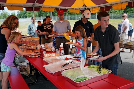 U.S. Marines and civilians of the Marine Corps Information Operations Center gather together for family day at Walt Hall, Quantico, Virginia, June 20, 2014. (U.S. Marine Corps photo by Sgt. Kristofer Atkinson/Released)
