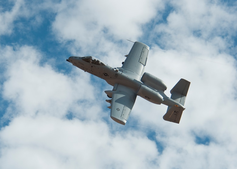 """An A-10 Thunderbolt II flies during the 2014 Hawgsmoke competition July 10, 2014, at the Barry M. Goldwater Range II in Tucson, Ariz. Hawgsmoke is a biennial worldwide A-10 bombing, missile, and tactical gunnery competition, which was derived from the discontinued """"Gunsmoke"""" Air Force Worldwide Gunnery Competition. The inaugural Hawgsmoke was in 2000 at the Alpena Combat Readiness Training Center in Michigan. (U.S. Air Force photo/Capt. Susan Harrington)"""