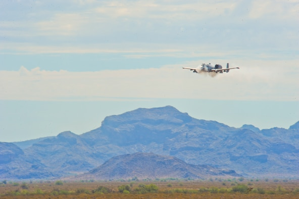 An A-10 Thunderbolt II strafes during the 2014 Hawgsmoke competition July 10, 2014, at the Barry M. Goldwater Range II in Tucson, Ariz. The 2014 Hawgsmoke competition focused on forward firing. The participants competed in high, medium, and low-angle strafes. (U.S. Air Force photo/Airman 1st Class Sivan Veazie)