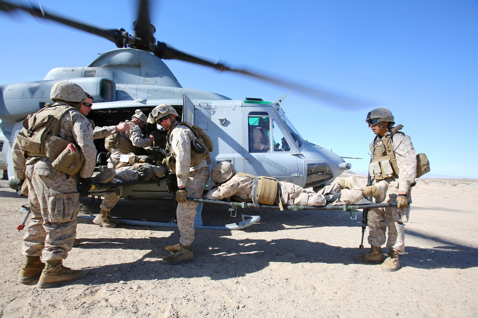 Marines and sailors with Combat Logistics Battalion 1, Combat Logistics Regiment 1, 1st Marine Logistics Group, evacuate a simulated casualty into a UH-1Y Huey during a Marine Readiness Exercise aboard Marine Corps Air Ground Combat Center Twenty-nine Palms, Calif., March 26, 2014. The MRX is part of the month-long Integrated Training Exercise 3-14 that prepares the battalion for its role as the logistics combat element in the final combat deployment of Operation Enduring Freedom.