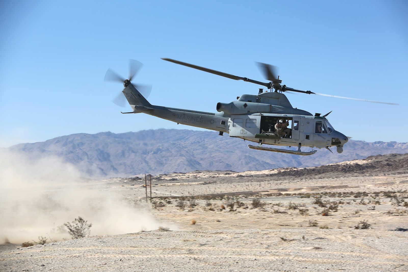 A UH-1Y Huey takes-off with simulated casualties when Combat Logistics Battalion 1, Combat Logistics Regiment 1, 1st Marine Logistics Group, conducted the Marine Readiness Exercise aboard Marine Corps Air Ground Combat Center Twenty-nine Palms, Calif., March 26, 2014. The MRX is part of the month-long Integrated Training Exercise 3-14 that prepares the battalion for its role as the logistics combat element in the final combat deployment in support of Operation Enduring Freedom.