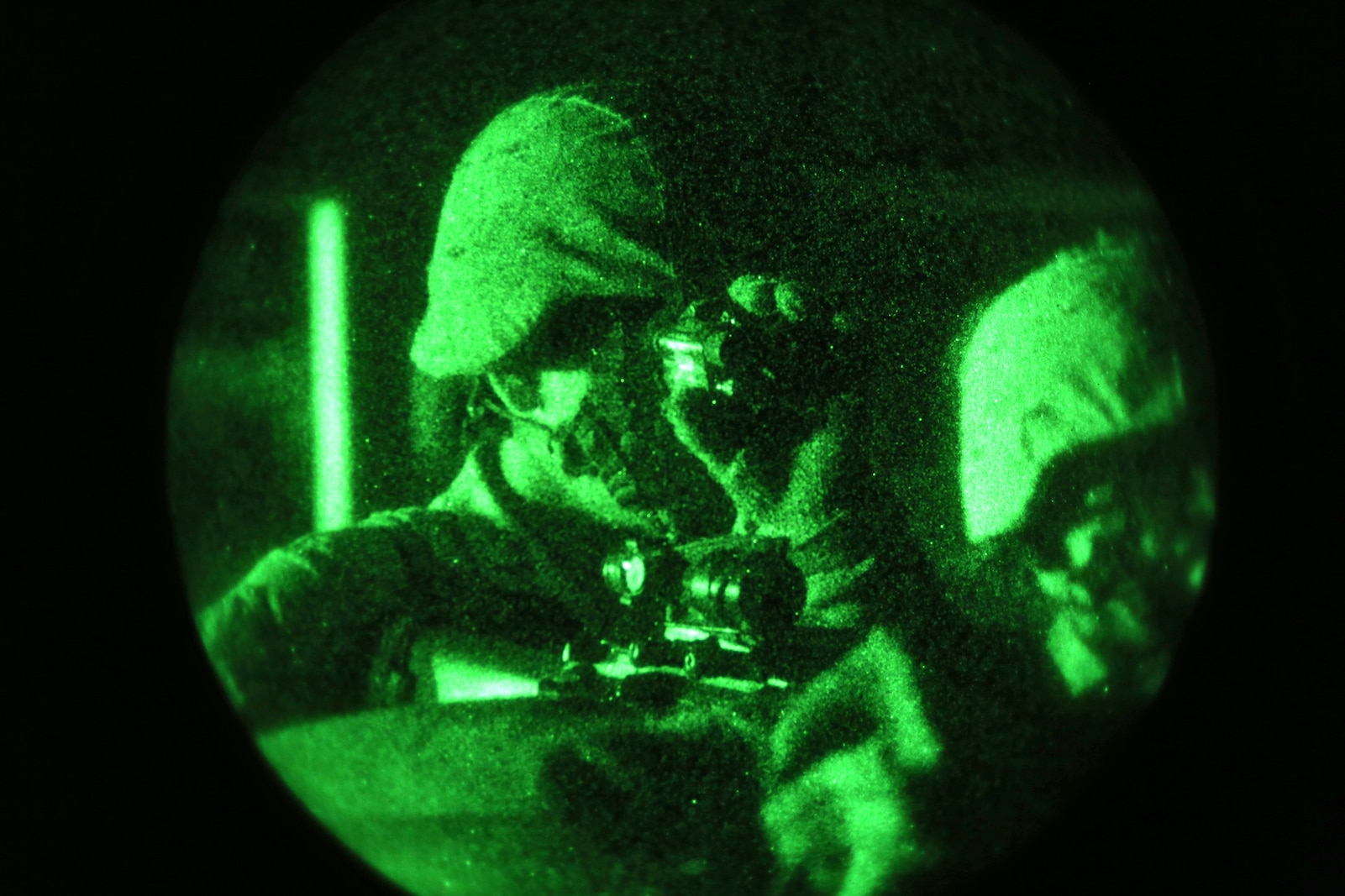 A Marine from Combat Logistics Battalion 1, Combat Logistics Regiment 1, 1st Marine Logistics Group, uses a night vision optic while on guard during the Marine Readiness Exercise aboard Marine Corps Air Ground Combat Center Twenty-nine Palms, Calif., March 25, 2014. The MRX is part of the month-long Integrated Training Exercise 3-14 that prepares the battalion for its role as the logistics combat element in the final combat deployment in support of Operation Enduring Freedom.
