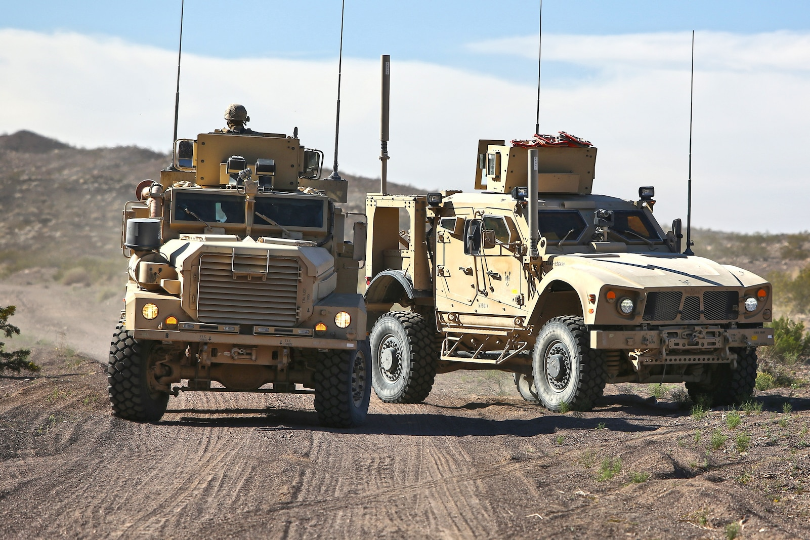 Marines with Combat Logistics Battalion 1, Combat Logistics Regiment 1, 1st Marine Logistics Group, conduct a combat logistics patrol during the Marine Readiness Exercise aboard Marine Corps Air Ground Combat Center Twenty-nine Palms, Calif., March 24, 2014. The MRX is the culminating exercise of the month-long Integrated Training Exercise 3-14 that prepares the battalion for its role, as the logistics combat element, in the final combat deployment in support of Operation Enduring Freedom.