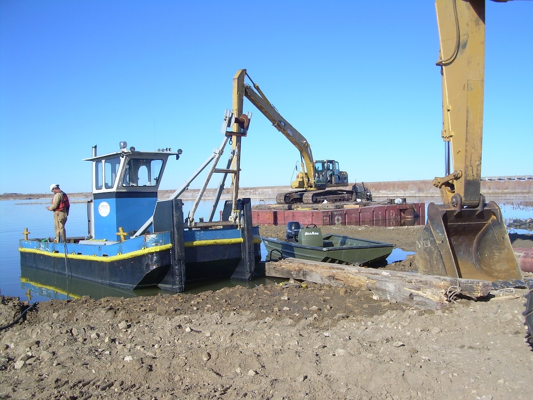 A Contractor transports equipment to the dredging site during dayshift operations from the staging area during a dredging operation at John Martin Dam, Colorado.