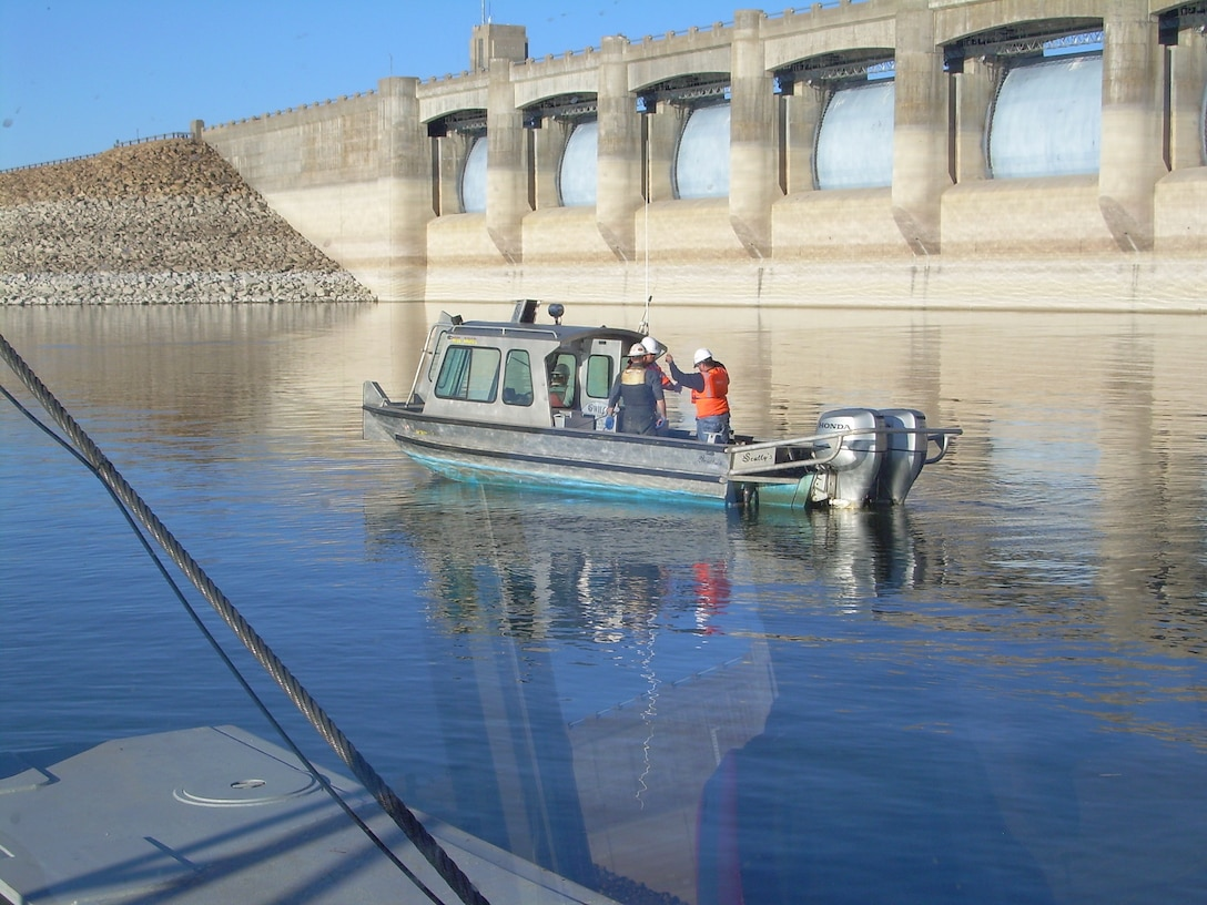 The contractor's support team performs dredging quality assurance operations during dayshift upstream of John Martin Dam in southeastern Colorado during dredging operations.