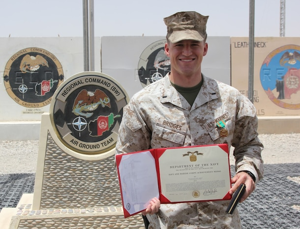 First Lt. Joshua Bridges, a native of Morganton, N.C., and assessments and plans officer, Regional Command (Southwest), poses for a photo after being  awarded a Navy and Marine Corps Achievement Medal during a ceremony aboard Camp Leatherneck, Afghanistan, July 13, 2014. Bridges deployed to Helmand province during Jan. 2014 and was vital to RC(SW) planning efforts during the 2014 Afghan presidential elections and the upcoming transition of full security responsibility to the Afghan National Security Forces in the region by the end of 2014.