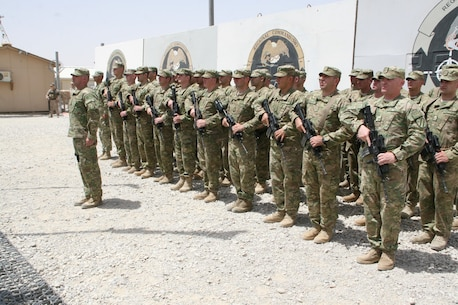 Soldiers with the Republic of Georgia stand in formation during their flag-lowering ceremony aboard Camp Leatherneck, Helmand province, Afghanistan, July 15, 2014. The ceremony marked the end of mission for the Georgian army serving with Regional Command (Southwest).