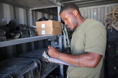 Corporal Charles Daniels, supply warehouse chief, 1st Battalion, 2nd Marine Regiment, takes inventory of some of the battalion's gear aboard Camp Leatherneck, Afghanistan, July 9, 2014. Daniels, a native of Baton Rouge, La., and only four other Marines are the responsible holders and maintainers of 1st Bn., 2nd Marines' $117 million supply of gear and equipment to be retrograded upon the unit's redeployment. (U.S. Marine Corps Photo By: Sgt. Frances Johnson)