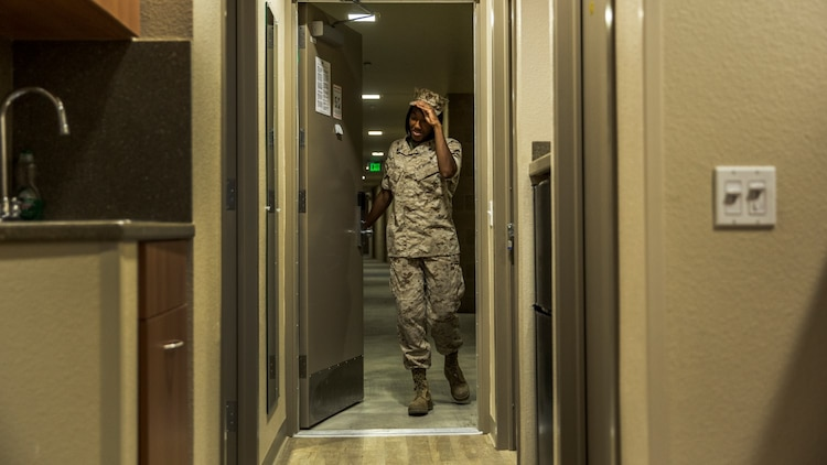 Corporal Ashton Tyler, warehouse clerk, 15th Marine Expeditionary Unit, retires to the comfort of her room after a hard day at work aboard Camp Pendleton, Calif., July 15, 2014. Tyler, 22, is from Charleston, South Carolina. (U.S. Marine Corps photo by Cpl. Emmanuel Ramos/Released)