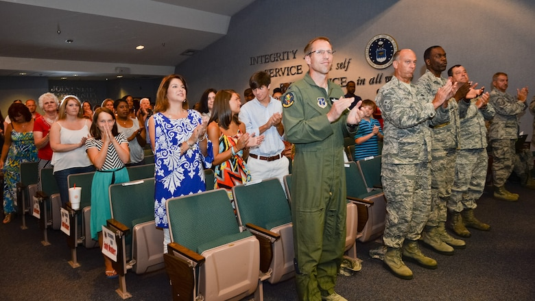 Family members, friends and coworkers cheer on members of the 202nd Engineering Installation Squadron (EIS), during a Hometown Heroes Salute ceremony at Robins Air Force Base, Ga., July 13, 2014.  Members of the 202nd EIS received numerous awards to include Bronze Star Medals, Air Force and Army Commendation and Achievement Medals and Hometown Heroes Awards for meritorious service while deployed in support of the global war on terrorism.   (U.S. Air National Guard photo by Master Sgt. Roger Parsons/Released)