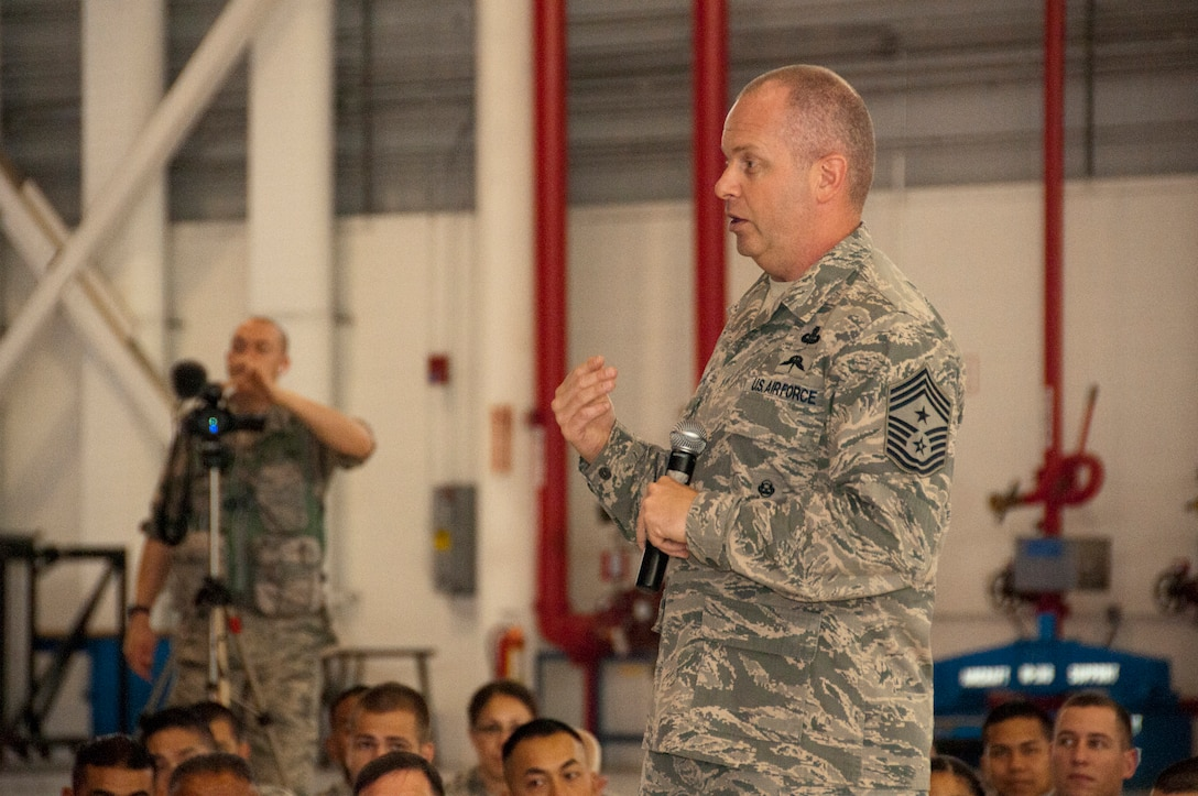 Air National Guard Command Chief James W. Hotaling speaks to members of the 129th Rescue Wing during a visit to Moffet Federal Airfield, Calif., July 12, 2014. Hotaling spoke to Airmen about the past, present and future of the ANG. (U.S. Air National Guard photo by Senior Airman Rachael Kane/Released)