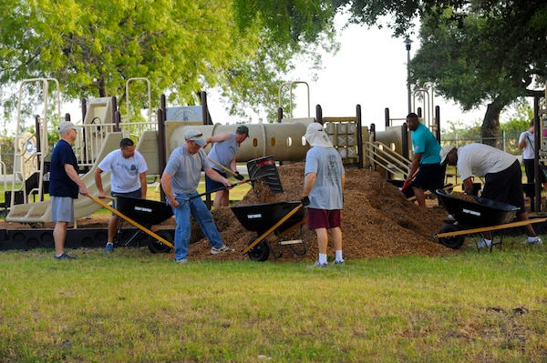 More than 20 enlisted Airmen participated in the Eberle Park Renovation project  July 12 at Joint Base San Antonio-Randolph. The day's mission included spreading mulch in playgrounds, adding sand to the outside volleyball court, power-washing, painting, and cleaning up. Volunteers were members of either the Randolph Top Three or Randolph Chief's Group. (U.S. Air Force photo by Senior Airman Kenna Jackson)