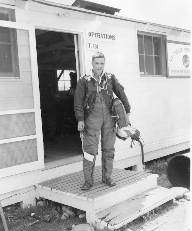 An Oregon ANG F-86 Sabre jet fighter pilot steps, ready to fly, on the doorstep of 123nd Fighter-Interceptor Squadron Operations at Gowen Field, Idaho,  June 17, 1954 (Courtesy 142FW History Archives)
